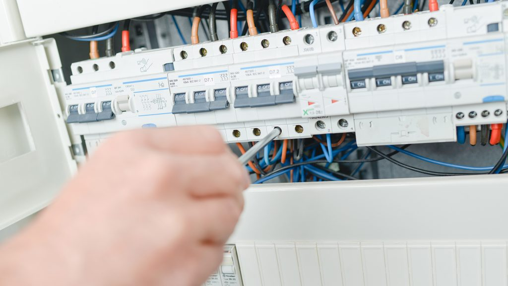 Electrician changing an circuit breaker